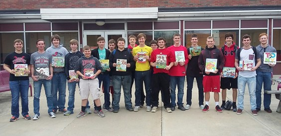 Baseball team members come prepared to read to the elementary students during Right To Read Week.